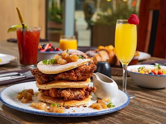 Fried Chicken and pancakes, mimosa in a champagne glass with a strawberry